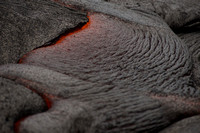Molten lava cooling to a crust