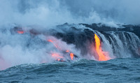 Lava and waterfall heading to ocean