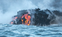 Cooled lava sliding towards the ocean