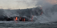 Lava flows meeting the ocean